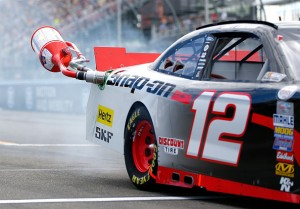 WATKINS GLEN, NY - AUGUST 08:  Joey Logano, driver of the #12 Snap-on Ford, leaves hit pit box with the fuel cannister still attached during the NASCAR XFINITY Series Zippo 200 at Watkins Glen International on August 8, 2015 in Watkins Glen, New York.  (Photo by Jonathan Ferrey/Getty Images)