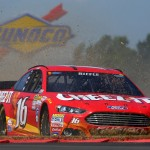 WATKINS GLEN, NY - AUGUST 09:  Greg Biffle, driver of the #16 Cheez-It Ford, has an on track incident during the NASCAR Sprint Cup Series Cheez-It 355 at the Glen at Watkins Glen International on August 9, 2015 in Watkins Glen, New York.  (Photo by Matt Sullivan/Getty Images)