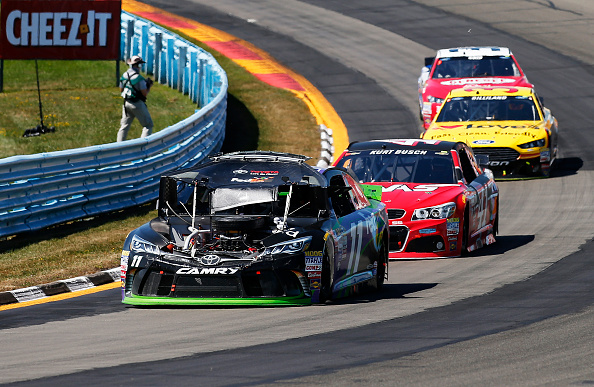 WATKINS GLEN, NY - AUGUST 09: Denny Hamlin, driver of the #11 FedEx Ground Toyota, races after an on track incident during the NASCAR Sprint Cup Series Cheez-It 355 at the Glen at Watkins Glen International on August 9, 2015 in Watkins Glen, New York.  (Photo by Todd Warshaw/Getty Images)