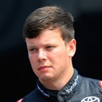 BROOKLYN, MI - AUGUST 14:  Erik Jones, driver of the #4 Toyota Toyota, stands in the garage area during practice for the NASCAR Camping World Truck Series Careers for Veterans 200 at Michigan International Speedway on August 14, 2015 in Brooklyn, Michigan.  (Photo by Chris Trotman/Getty Images)