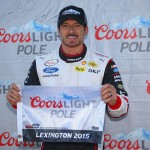 LEXINGTON, OH - AUGUST 15:  Alex Tagliani, driver of the #22 Discount Tire Ford, poses for pictures after winning the pole for the 3rd Annual Nationwide Children's Hospital 200 at Mid-Ohio Sports Car Course on August 15, 2015 in Lexington, Ohio.  (Photo by Matt Sullivan/Getty Images)