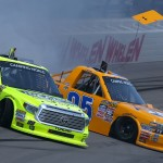 BROOKLYN, MI - AUGUST 15:  Matt Crafton, driver of the #88 Ideal Door/Menards Toyota, and John Wes Townley, driver of the #05 Zaxby's Chevrolet, make contact during the NASCAR Camping World Truck Series Careers for Veterans 200 at Michigan International Speedway on August 15, 2015 in Brooklyn, Michigan.  (Photo by Sarah Crabill/Getty Images)