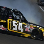 BROOKLYN, MI - AUGUST 15:  Cody Coughlin, driver of the #54 JEGS Toyota, is involved in an on-track incident during the NASCAR Camping World Truck Series Careers for Veterans 200 at Michigan International Speedway on August 15, 2015 in Brooklyn, Michigan.  (Photo by Sarah Crabill/Getty Images)
