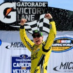 BROOKLYN, MI - AUGUST 15:  Kyle Busch, driver of the #51 Dollar General Toyota, celebrates in victory lane after winning the NASCAR Camping World Truck Series Careers for Veterans 200 at Michigan International Speedway on August 15, 2015 in Brooklyn, Michigan.  (Photo by Chris Trotman/Getty Images)