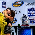 BROOKLYN, MI - AUGUST 15:  Kyle Busch, driver of the #51 Dollar General Toyota, celebrates with his wife Samanta in victory lane after his victory in the NASCAR Camping World Truck Series Careers for Veterans 200 at Michigan International Speedway on August 15, 2015 in Brooklyn, Michigan.  (Photo by Chris Trotman/Getty Images)