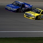 BROOKLYN, MI - AUGUST 15:  Kyle Busch, driver of the #51 Dollar General Toyota, and Ryan Blaney, driver of the #29 Cooper Standard Careers for Vets Ford, race into a corner during the NASCAR Camping World Truck Series Careers for Veterans 200 at Michigan International Speedway on August 15, 2015 in Brooklyn, Michigan.  (Photo by Jerry Markland/Getty Images)