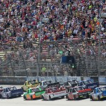 BROOKLYN, MI - AUGUST 15:  Drivers cross the start-finish line for a restart during the NASCAR Camping World Truck Series Careers for Veterans 200 at Michigan International Speedway on August 15, 2015 in Brooklyn, Michigan.  (Photo by Jerry Markland/Getty Images)