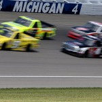BROOKLYN, MI - AUGUST 15:  Drivers race into a corner during the NASCAR Camping World Truck Series Careers for Veterans 200 at Michigan International Speedway on August 15, 2015 in Brooklyn, Michigan.  (Photo by Jerry Markland/Getty Images)