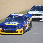 LEXINGTON, OH - AUGUST 15:  Chase Elliott, driver of the #9 NAPA Auto Parts Chevrolet, races Brian Scott, driver of the #2 Shore Lodge Chevrolet, during the Nationwide Children's Hospital 200 at Mid-Ohio Sports Car Course on August 15, 2015 in Lexington, Ohio.  (Photo by Matt Sullivan/Getty Images)