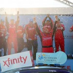 LEXINGTON, OH - AUGUST 15: Regan Smith, driver of the #7 Nationwide Children's Hospital Chevrolet, celebrates with his team after winning the NASCAR XFINITY Series Nationwide Children's Hospital 200 at Mid-Ohio Sports Car Course on August 15, 2015 in Lexington, Ohio. (Photo by Jeff Curry/Getty Images)