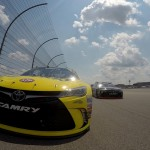 BROOKLYN, MI - AUGUST 16:  Matt Kenseth, driver of the #20 Dollar General Toyota, and Denny Hamlin, driver of the #11 FedEx Freight Toyota, lead the field during parade laps before the NASCAR Sprint Cup Series Pure Michigan 400 at Michigan International Speedway on August 16, 2015 in Brooklyn, Michigan.  (Photo by Sarah Crabill/Getty Images)