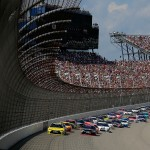BROOKLYN, MI - AUGUST 16:  Matt Kenseth, driver of the #20 Dollar General Toyota, and Denny Hamlin, driver of the #11 FedEx Freight Toyota, lead the field during the NASCAR Sprint Cup Series Pure Michigan 400 at Michigan International Speedway on August 16, 2015 in Brooklyn, Michigan.  (Photo by Chris Trotman/Getty Images)