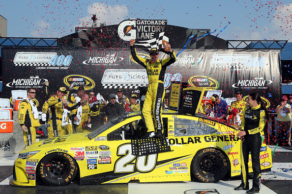 Matt Kenseth celebrates after winning the NASCAR Sprint Cup Series Pure Michigan 400 at Michigan International Speedway on August 16, 2015 in Brooklyn, Michigan.
