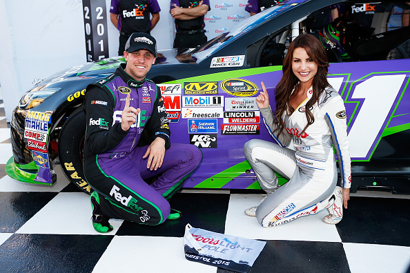 Denny Hamlin, driver of the #11 FedEx Ground Toyota, poses with Miss Coors Light Amanda Mertz and the Coors Light Pole Award Decal after qualifying for the pole position for the NASCAR Sprint Cup Series Irwin Tools Night Race at Bristol Motor Speedway on August 21, 2015 in Bristol, Tennessee. (Photo by Gregory Shamus/Getty Images)