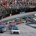 BRISTOL, TN - AUGUST 21:  Denny Hamlin, driver of the #20 Hisense Toyota, and Kyle Busch, driver of the #54 Monster Energy Toyota, lead the field through the green flag to start the NASCAR XFINITY Series Food City 300 at Bristol Motor Speedway on August 21, 2015 in Bristol, Tennessee.  (Photo by Brian Lawdermilk/Getty Images)