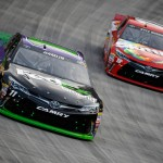 BRISTOL, TN - AUGUST 22:  Denny Hamlin, driver of the #11 FedEx Ground Toyota, races Kyle Busch, driver of the #18 Skittles Toyota, during the NASCAR Sprint Cup Series IRWIN Tools Night Race at Bristol Motor Speedway on August 22, 2015 in Bristol, Tennessee.  (Photo by Gregory Shamus/Getty Images)