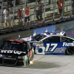 BRISTOL, TN - AUGUST 22:  Martin Truex Jr., driver of the #78 Furniture Row/Visser Precision Chevrolet, and Ricky Stenhouse Jr., driver of the #17 Fastenal Ford, are involved in an on-track incident during the NASCAR Sprint Cup Series IRWIN Tools Night Race at Bristol Motor Speedway on August 22, 2015 in Bristol, Tennessee.  (Photo by Brian Lawdermilk/Getty Images)