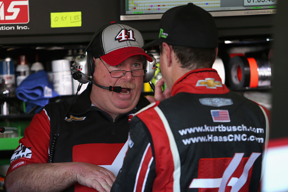 AVONDALE, AZ - NOVEMBER 07: Kurt Busch, driver of the #41 Haas Automation Chevrolet, talks to his crew chief, Tony Gibson (L), in the garage area during practice for the NASCAR Sprint Cup Series Quicken Loans Race for Heroes 500 at Phoenix International Raceway on November 7, 2014 in Avondale, Arizona.  (Photo by Todd Warshaw/Getty Images)