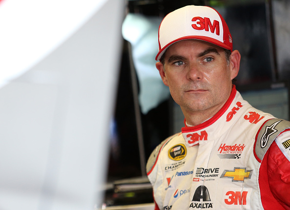 Jeff Gordon stands in the garage area during practice for the NASCAR Sprint Cup Series Bojangles' Southern 500 at Darlington Raceway on September 4, 2015 in Darlington, South Carolina.