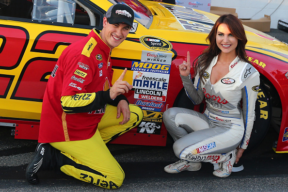 Joey Logano, driver of the #22 Shell Pennzoil Ford, poses with Miss Coors Light Amanda Mertz and the Coors Light Pole award after qualifying for the pole position for the NASCAR Sprint Cup Series Federated Auto Parts 400 at Richmond International Raceway on September 11, 2015 in Richmond, Virginia. (Photo by Sarah Crabill/Getty Images)