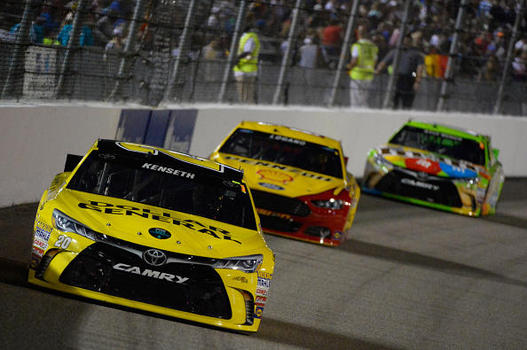 RICHMOND, VA - SEPTEMBER 12: Matt Kenseth, driver of the #20 Dollar General Toyota, leads a pack of cars during the NASCAR Sprint Cup Series Federated Auto Parts 400 at Richmond International Raceway on September 12, 2015 in Richmond, Virginia.  (Photo by Robert Laberge/Getty Images)