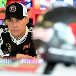 JOLIET, IL - SEPTEMBER 18:  Kevin Harvick, driver of the #4 Jimmy John's / Budweiser Chevrolet, stands in the garage area before practice for the NASCAR Sprint Cup Series myAFibRisk.com 400 at Chicagoland Speedway on September 18, 2015 in Joliet, Illinois.  (Photo by Josh Hedges/Getty Images)