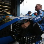 JOLIET, IL - SEPTEMBER 18:  Clint Bowyer, driver of the #15 PEAK Antifreeze & Coolant Toyota, gets in his car during practice for the NASCAR Sprint Cup Series myAFibRisk.com 400 at Chicagoland Speedway on September 18, 2015 in Joliet, Illinois.  (Photo by Matt Sullivan/Getty Images)