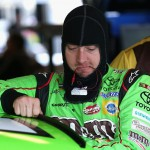 JOLIET, IL - SEPTEMBER 19:  Kyle Busch, driver of the #18 M&M's Crispy Toyota, stands in the garage area during practice for the NASCAR Sprint Cup Series MyAFibRisk.com 400 at Chicagoland Speedway on September 19, 2015 in Joliet, Illinois.  (Photo by Jonathan Daniel/Getty Images)