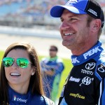 JOLIET, IL - SEPTEMBER 20:  Danica Patrick, driver of the #10 Aspen Dental Chevrolet, and Clint Bowyer, driver of the #15 PEAK Antifreeze & Coolant Toyota, talk on the grid prior to the NASCAR Sprint Cup Series myAFibRisk.com 400 at Chicagoland Speedway on September 20, 2015 in Joliet, Illinois.  (Photo by Kena Krutsinger/Getty Images)