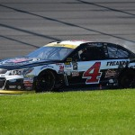 JOLIET, IL - SEPTEMBER 20:  Kevin Harvick, driver of the #4 Jimmy John's / Budweiser Chevrolet, sits in the grass after an incident on the track during the NASCAR Sprint Cup Series myAFibRisk.com 400 at Chicagoland Speedway on September 20, 2015 in Joliet, Illinois.  (Photo by Josh Hedges/Getty Images)