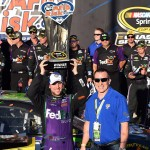 JOLIET, IL - SEPTEMBER 20:  Denny Hamlin, driver of the #11 FedEx Ground Toyota, celebrates in Victory Lane after winning the NASCAR Sprint Cup Series myAFibRisk.com 400 at Chicagoland Speedway on September 20, 2015 in Joliet, Illinois.  (Photo by Josh Hedges/Getty Images)