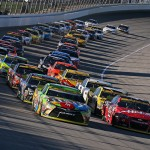 JOLIET, IL - SEPTEMBER 20:  Kyle Busch, driver of the #18 M&M's Crispy Toyota, and Kurt Busch, driver of the #41 Haas Automation Chevrolet, lead a pack of cars during the NASCAR Sprint Cup Series myAFibRisk.com 400 at Chicagoland Speedway on September 20, 2015 in Joliet, Illinois.  (Photo by Jonathan Daniel/Getty Images)
