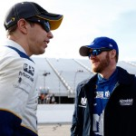 LOUDON, NH - SEPTEMBER 25:  Brad Keselowski, driver of the #2 Miller Lite Ford, speaks with Dale Earnhardt Jr., driver of the #88 Nationwide Chevrolet, during qualifying for the NASCAR Sprint Cup Series Sylvania 300 at New Hampshire Motor Speedway on September 25, 2015 in Loudon, New Hampshire.  (Photo by Jeff Zelevansky/Getty Images)