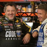 LOUDON, NH - SEPTEMBER 25:  Tony Stewart, driver of the #14 Code 3 Associates/Mobil 1 Chevrolet, and AJ Allmendinger, driver of the #47 Bush's Chili Beans Chevrolet, speak in the garage during practice for the NASCAR Sprint Cup Series Sylvania 300 at New Hampshire Motor Speedway on September 25, 2015 in Loudon, New Hampshire.  (Photo by Vaughn Ridley/Getty Images)
