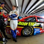 LOUDON, NH - SEPTEMBER 26:  Clint Bowyer, left, driver of the #15 5-Hour Energy Toyota, talks with Jamie McMurray, driver of the #1 FLIR Chevrolet, in the garage area during practice for the NASCAR Sprint Cup Series Sylvania 300 at New Hampshire Motor Speedway on September 26, 2015 in Loudon, New Hampshire.  (Photo by Jared C. Tilton/Getty Images)