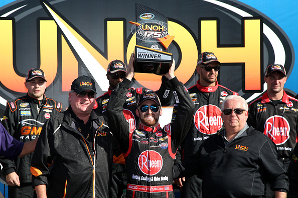 Austin Dillon, driver of the #33 Rheem Chevrolet, celebrates in Victory Lane after winning the NASCAR Camping World Truck Series UNOH 175 at New Hampshire Motor Speedway on September 26, 2015 in Loudon, New Hampshire. (Photo by Sean Gardner/Getty Images)