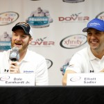DOVER, DE - OCTOBER 02:  (L-R) Team owner Dale Earnhardt Jr. and Elliott Sadler, driver of the #1 OneMain Financial Ford, speak to the media before practice for the NASCAR XFINITY Series Hisense 200 at Dover International Speedway on October 2, 2015 in Dover, Delaware.  (Photo by Brian Lawdermilk/Getty Images)
