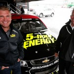 DOVER, DE - OCTOBER 02:  (L-R) Driver Clint Bowyer and team owner Harry Scott Jr. pose with the 2016 car after announcing plans for Bowyer to drive for HScott Motorsports, sponsored by 5 Hour Energy, after rain canceled practice and qualifying for the NASCAR Sprint Cup Series AAA 400 at Dover International Speedway on October 2, 2015 in Dover, Delaware.  (Photo by Brian Lawdermilk/Getty Images)