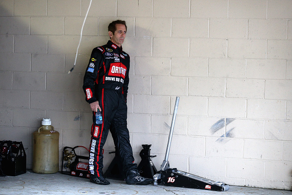 Greg Biffle, driver of the #16 Ortho Ford, looks on in the garage area during practice for the NASCAR Sprint Cup Series AAA 400 at Dover International Speedway on October 3, 2015 in Dover, Delaware. (Photo by Patrick Smith/Getty Images)