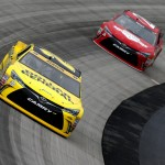 DOVER, DE - OCTOBER 03:  Matt Kenseth, driver of the #20 Dollar General Toyota, leads JJ Yeley, driver of the #26 Maxim Fantasy Toyota, during practice for the NASCAR Sprint Cup Series AAA 400 at Dover International Speedway on October 3, 2015 in Dover, Delaware.  (Photo by Brian Lawdermilk/Getty Images)