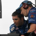 DOVER, DE - OCTOBER 03:  Elliott Sadler, driver of the #1 OneMain Financial Ford, left, talks with crew chief Phil Gould during a red flag period for rain during the NASCAR XFINITY Series Hisense 200 at Dover International Speedway on October 3, 2015 in Dover, Delaware.  (Photo by Brian Lawdermilk/Getty Images)