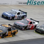 DOVER, DE - OCTOBER 03:  Brendan Gaughan, driver of the #62 South Point Chevrolet, leads a pack of cars during the NASCAR XFINITY Series Hisense 200 at Dover International Speedway on October 3, 2015 in Dover, Delaware.  (Photo by Jerry Markland/Getty Images)