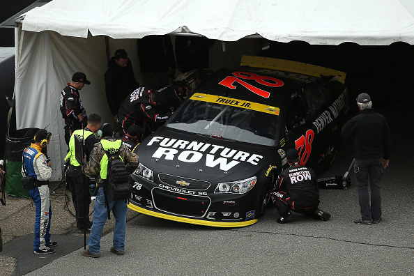 The car of Martin Truex Jr. undergoes inspection prior to the NASCAR Sprint Cup Series AAA 400 at Dover International Speedway on October 4, 2015 in Dover, Delaware.