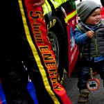 DOVER, DE - OCTOBER 04:  Cash Bowyer, son of Clint Bowyer, driver of the #15 5-hour Energy Toyota, stands on the grid before the NASCAR Sprint Cup Series AAA 400 at Dover International Speedway on October 4, 2015 in Dover, Delaware.  (Photo by Will Schneekloth/Getty Images)