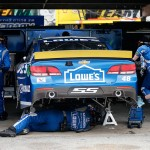 DOVER, DE - OCTOBER 04:  Crew members for Jimmie Johnson, driver of the #48 Lowe's Chevrolet, work to repair his car in the garagea during the NASCAR Sprint Cup Series AAA 400 at Dover International Speedway on October 4, 2015 in Dover, Delaware.  (Photo by Brian Lawdermilk/Getty Images)