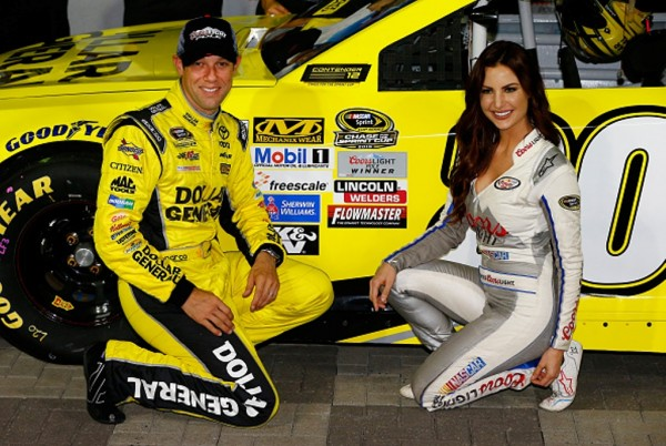 Matt Kenseth and Amanda Mertz post after he won the pole for the NASCAR Sprint Cup Series Bank of America 500 at Charlotte Motor Speedway on October 8, 2015 in Charlotte, North Carolina.