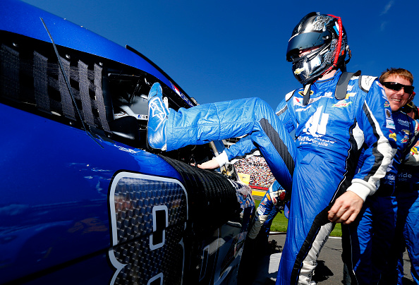 CHARLOTTE, NC - OCTOBER 11:  Dale Earnhardt Jr., driver of the #88 Nationwide Chevrolet, climbs into his car on the grid prior to the NASCAR Sprint Cup Series Bank of America 500 at Charlotte Motor Speedway on October 11, 2015 in Charlotte, North Carolina.  (Photo by Jonathan Ferrey/Getty Images)