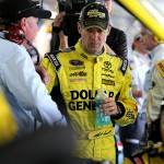 CHARLOTTE, NC - OCTOBER 11:  Matt Kenseth, driver of the #20 Dollar General Toyota, looks on as crew members work on his car in the garage area during the NASCAR Sprint Cup Series Bank of America 500 at Charlotte Motor Speedway on October 11, 2015 in Charlotte, North Carolina.  (Photo by Jerry Markland/Getty Images)
