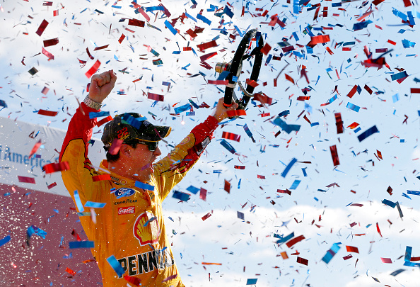 Joey Logano celebrates after the NASCAR Sprint Cup Series Bank of America 500 at Charlotte Motor Speedway on October 11, 2015 in Charlotte, North Carolina.