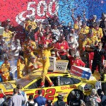 CHARLOTTE, NC - OCTOBER 11:  Joey Logano, driver of the #22 Shell Pennzoil Ford, celebrates in Victory Lane after winning the NASCAR Sprint Cup Series Bank of America 500 at Charlotte Motor Speedway on October 11, 2015 in Charlotte, North Carolina.  (Photo by Streeter Lecka/Getty Images)